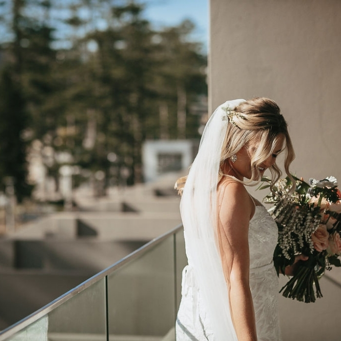 bride on the morning of her wedding overlooking manly beadh